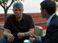 Il regista Alexander Sokurov intervistato dal fotografo Octavian Micleusanu sulla terrazza dell'Excelsior alla 72a Mostra del Cinema di Venezia. Foto Valentina Zanaga